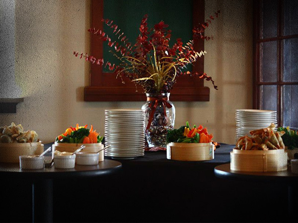 A beautiful arraingment of custom catered food for a business event.